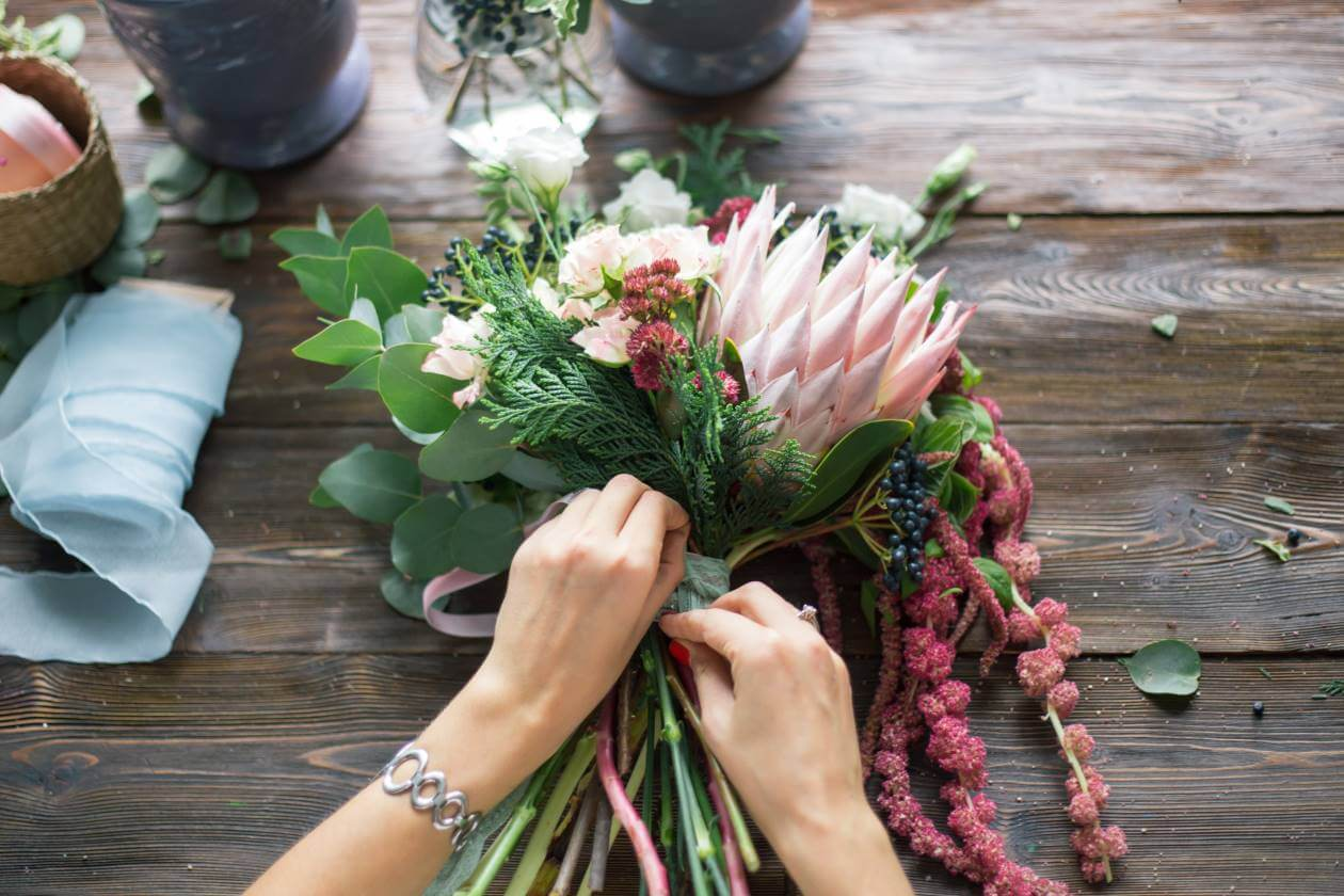 fair trade flower present women making flower