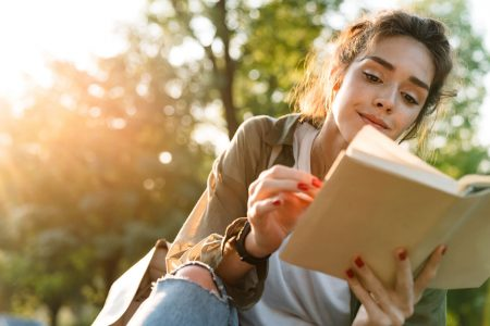 Woman reading book on sustainable living