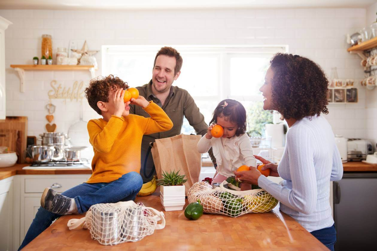 family in kitchen talking about food waste in schools