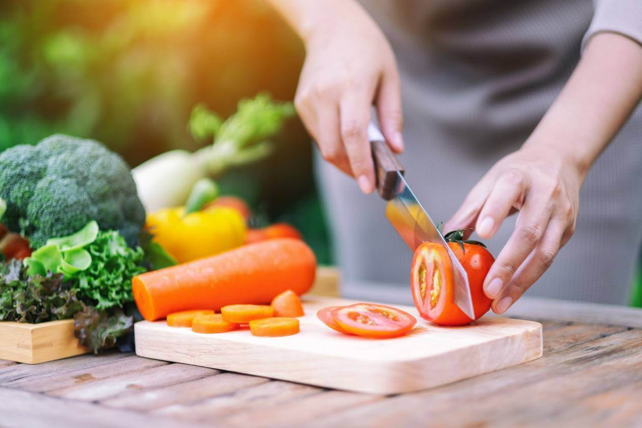 cutting up vegetables and fruits